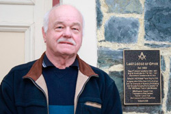 Lake Lodge of Ophir Worshipful Master Martin Chappell with the commemorative plaque laid on the historic Marine Pde building in 2008. PHOTO: SUPPLIED